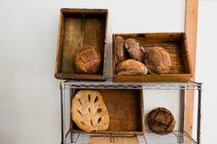 Artisan bread on a shelf against a white wall. stock photos