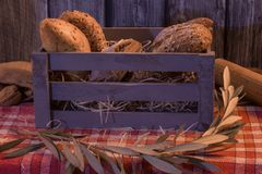 Artisan breads in a wooden box with wooden background stock image
