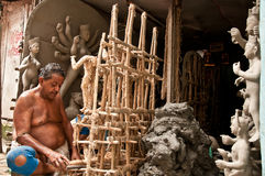 Artisan builds the framework for creating idols Royalty Free Stock Photo