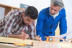 Artisan carpenter demonstrating knowledge. Artisan carpenter demonstrating his knowledge Stock Images