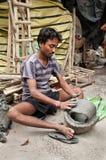 Artisan crafting clay idol Stock Photos
