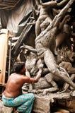 Artisan creating clay idol Stock Images