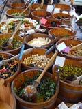Artisan food market. Artisan food in wooden buckets at farmers market stock photography