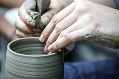 Artisan hands making clay pot handmade pottery workshop. Artisan hand making clay pot handmade pottery workshop stock images