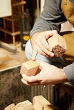 Artisan hands with wood billets Royalty Free Stock Photo