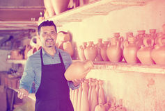 Artisan having ceramics in hands in pottery studio Royalty Free Stock Images