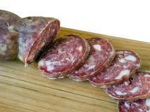Artisan homemade salami, sausage on board. Royalty Free Stock Image