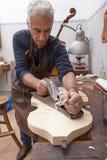 Artisan lutemaker working a violin Stock Photos