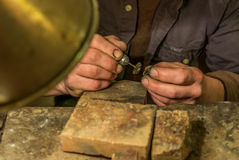 Artisan making a silver ring - 4 Royalty Free Stock Images