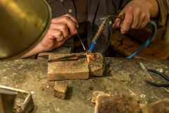 Artisan making a silver ring - 2 Royalty Free Stock Images
