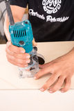 Artisan with a milling machine. Milling machine being used to craft a cajon flamenco percussion instrument Stock Photos
