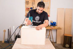 Artisan with a milling machine. Milling machine being used to craft a cajon flamenco percussion instrument Stock Images