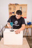 Artisan with a milling machine. Milling machine being used to craft a cajon flamenco percussion instrument Royalty Free Stock Image