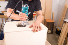 Artisan with a milling machine. Milling machine being used to craft a cajon flamenco percussion instrument Stock Image