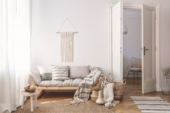 Artisan and natural decorations and accessories in a warm living room interior with wooden furniture and hardwood floor. Concept royalty free stock photography