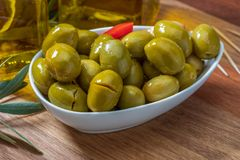 Artisan olives canned in extra virgin olive oil. stock photo