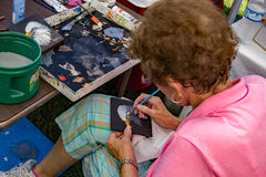 Artisan Painting an Eagle's Head Stock Photography