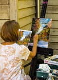 Artisan Painting a Landscape Scene Royalty Free Stock Images