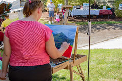 Artisan Painting a Landscape Scene Stock Image