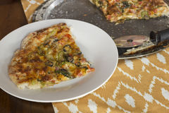 Artisan Pizza. Home made artisan veggie pizza pie with onions peppers spinach and olives Royalty Free Stock Image
