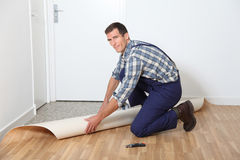 Artisan putting new flooring Royalty Free Stock Images