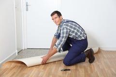 Artisan putting new flooring. Closeup of artisan installing new flooring Royalty Free Stock Images
