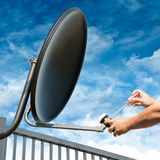 Artisan Repair Satellite Dish Photos stock