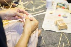 Artisan's hand weaves the decorative handmade ratten product Stock Photo