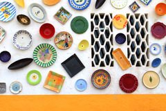 Artisan's wall of handpainted plates Royalty Free Stock Photos