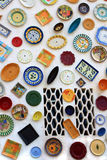 Artisan's wall of handpainted plates Stock Photos