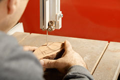 Artisan sawing billet Stock Image