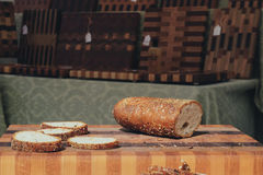 Artisan sliced bread. Bread loaf sliced on custom artisan cutting board Royalty Free Stock Photography