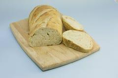 Fresh Artisan Bread on Wood Cutting Board Royalty Free Stock Photography