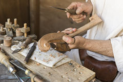 Artisan who prepares a musical instrument Stock Photography