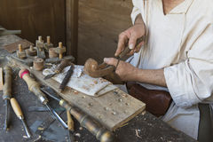 Artisan who prepares a musical instrument Royalty Free Stock Image