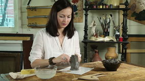 Artisan woman shaping clay sculpture stock footage