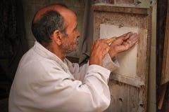 Artisan at work. Marrakesh. Morocco. An artisan working at the Souk. Marrakesh. Morocco Royalty Free Stock Images