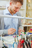 Artisan working in jewelry workshop Stock Images