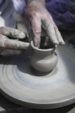 Artisan is working with raw clay Royalty Free Stock Photos