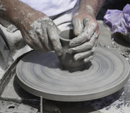 Artisan is working with raw clay. Artisan hands making clay pot stock photography