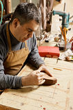 Artisan in workshop drawing on billet Stock Image