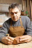 Artisan in workshop with wood Stock Photo