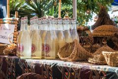 Artisanal cheese for sale at artisan market in Ile rousse. L`Ile Rousse, Corsica - 30th September 2018. Artisanal Kombucha tea and wicker baskets are displayed royalty free stock image