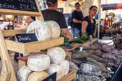 Artisanal cheese for sale at artisan market in Ile rousse. L`Ile Rousse, Corsica - 30th September 2018. Locally made cheeses and cured meats are displayed for stock photo