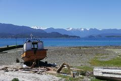 Artisanal fishing boats in Hualaiué, Los Lagos region, Southern Chile. Hualaiué is a remote cove in the Province of Palena, Los Lagos region. One of the stock image