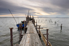 Artisanal fishing pier at sunset Stock Photos