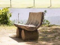Artisanal riverside bench Royalty Free Stock Photography