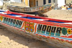 Artisanal wooden fishing boats pirogues in the Petite Côte of Senegal, Western Africa. Artisanal wooden fishing boats pirogues in the Petite Côte of Stock Photography