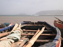 Artisanal wooden fishing boats in Sao Vicente, one of the Cape Verde islands. Handlining is a fishing method in which a line with a hook, usually baited, is Royalty Free Stock Images