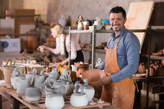 Artisans in ceramics workroom with pottery wheel Royalty Free Stock Photo